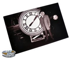 "Photograph of Christopher Lloyd as ""Doc Brown"" in front of the clock from Back to the Future III"
