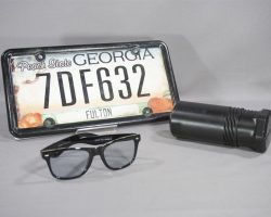 BABY DRIVER BABY ANSEL ELGORT SCREEN USED SUNGLASSES & LICENSE PLATE