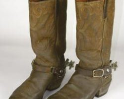 John Wayne signature western boots and spurs.