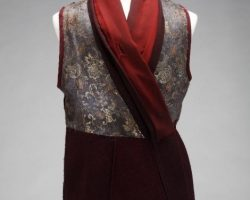 An ornate burgundy tunic with gold detailing worn by a Zion soldier
