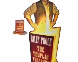 "Justin Bartha ""Riley Poole"" prop standee and books from National Treasure: Book of Secrets"